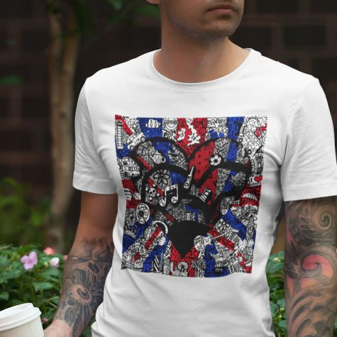 t-shirt-mockup-featuring-a-tattooed-man-holding-a-man-posing-by-a-planter-with-flowers-1956-el1
